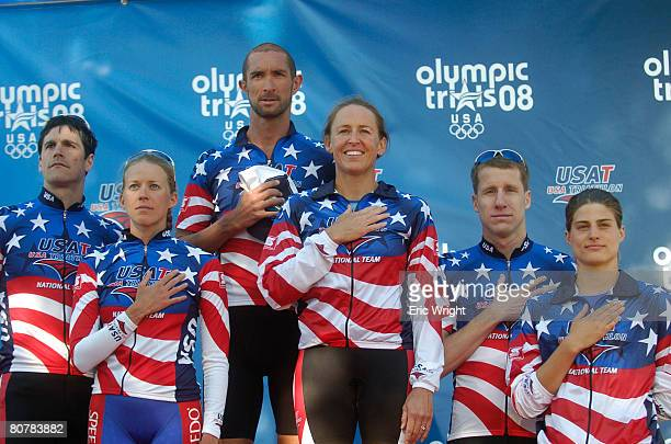 Andy Potts left Sarah Haskins Matthew Reed Julie Swail Ertel Hunter Kemper and Sarah Goff clisten to the National Anthem while on the podium after...