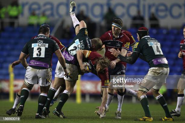 Andy Powell of Sale Sharks is lifted off the ground by David Paice of London Irish who received a yellow card for the offence during the Aviva...