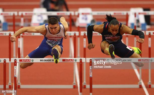 Andy Pozzi of Great Britain and Pascal MartinotLagarde of France compete in the Men's 60 metres hurdles final on day one of the 2017 European...