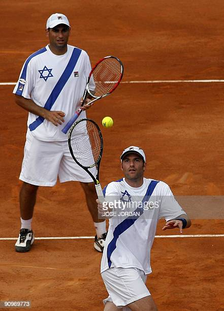 Andy Ram and Jonathan Erlich from Israel return the ball to Feliciano Lopez and Tommy Robredo from Spain during the semifinal Davis Cup match between...