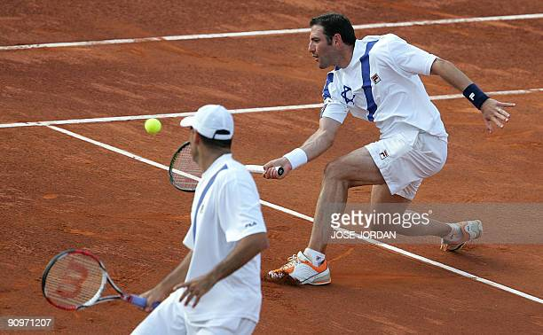 Andy Ram and Jonathan Erlich from Israel return the ball to Spain's Feliciano Lopez and Tommy Robredo during the third match of the Davis cup...