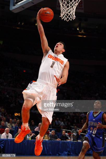 Andy Rautins of the Syracuse Orange drives to the hoop against the Seton Hall Pirates during the second round of the Big East Tournament at Madison...