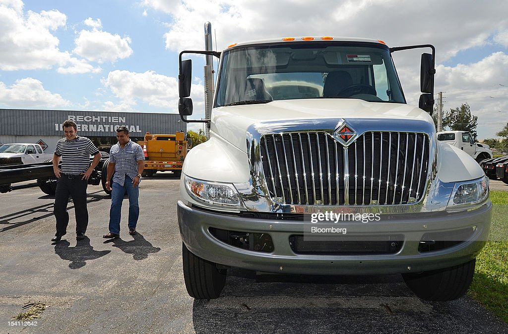 Andy Rechtien, left, an account manager at Rechtien International Trucks Inc., shows customer Raimundo Delgado, the Navistar Inc. International Truck DuraStar at Rechtien International Trucks, Inc., in Miami, Florida, U.S. on Friday, Oct. 12, 2012. The U.S. Census Bureau is scheduled to release business inventories figures on Oct. 15. Photographer: Mark Elias/Bloomberg via Getty Images