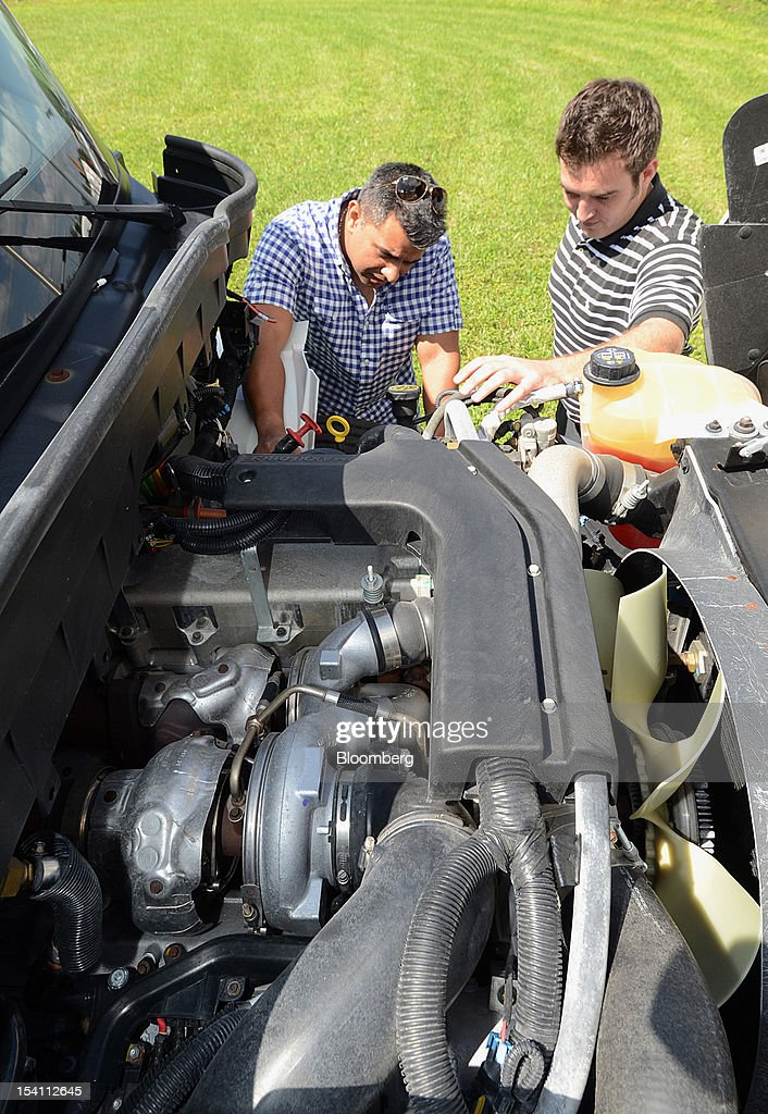 Andy Rechtien, right, account manager at Rechtien International Trucks Inc., shows customer Raimundo Delgado, the MaxxForce Turbo Diesel engine that powers Navistar Inc. International Truck's DuraStar at Rechtien International Trucks, Inc., in Miami, Florida, U.S. on Friday, Oct. 12, 2012. The U.S. Census Bureau is scheduled to release business inventories figures on Oct. 15. Photographer: Mark Elias/Bloomberg via Getty Images