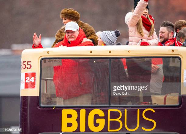 Andy Reid head coach of the Kansas City Chiefs and his wife Tammy wave to fans on February 5 2020 in Kansas City Missouri during the citys...