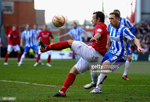 Andy Reid of Nottingham Forest battles with Andrew Crofts of Brighton during the npower Championship match between Nottingham Forest and Brighton and...