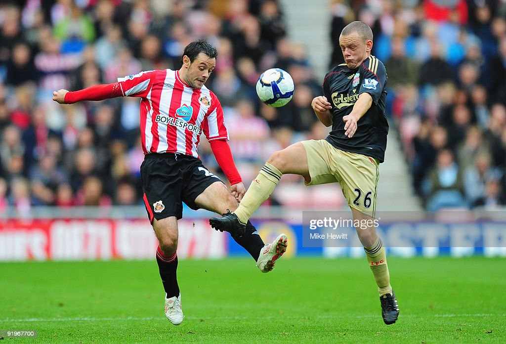 Andy Reid of Sunderland is challenged by Jay Spearing of Liverpool during the Barclays Premier League match between Sunderland and Liverpool at the Stadium of Light on October 17, 2009 in Sunderland, England.