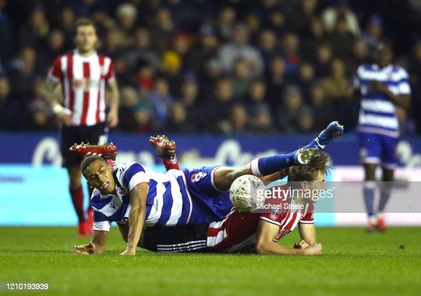 Andy Rinomhota of Reading FC and Sander Berge of Sheffield United clash during the FA Cup Fifth Round match between Reading FC and Sheffield United...