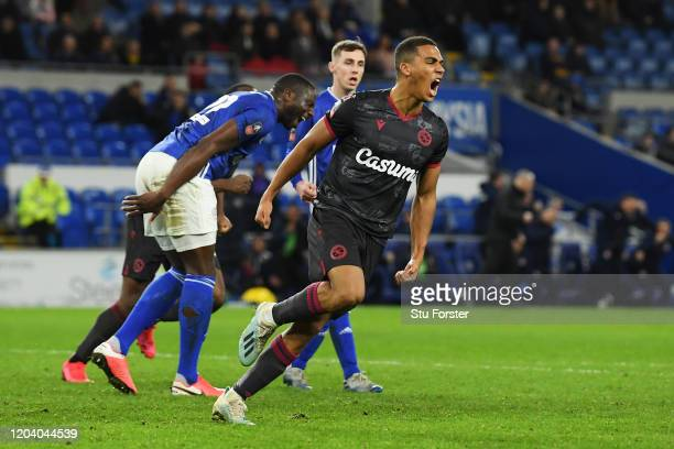 Andy Rinomhota of Reading FC celebrates after scoring his team's second goal during the FA Cup Fourth Round Replay match between Cardiff City and...
