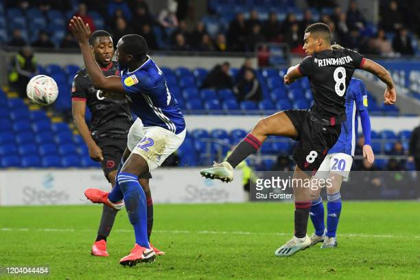 Andy Rinomhota of Reading FC scores his team's second goal during the FA Cup Fourth Round Replay match between Cardiff City and Reading FC at Cardiff...