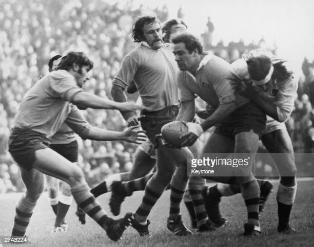 Andy Ripley of England tackles Bruce Battishall of Australia during an International at Twickenham 17th November 1973