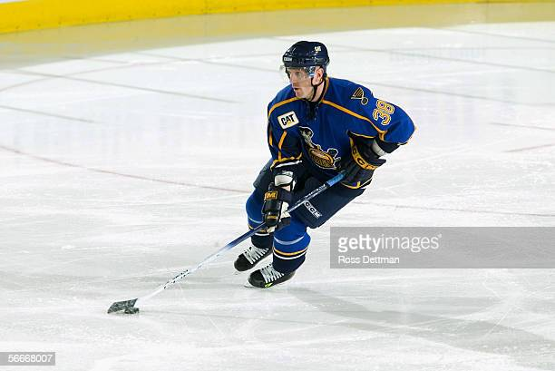 Andy Roach of the Peoria Rivermen skates with the puck against the Chicago Wolves at Allstate Arena on December 11 2005 in Rosemont Illinois The...