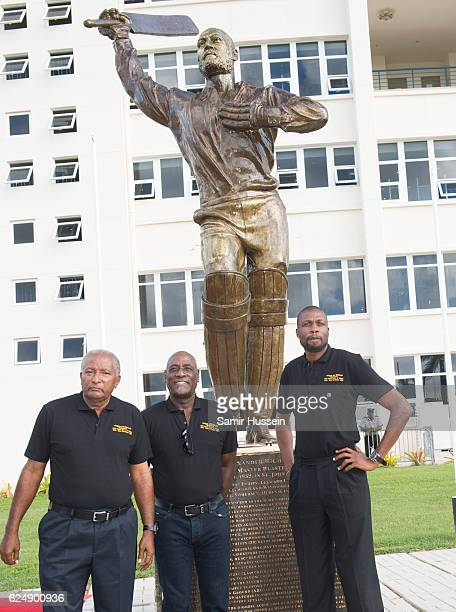 Andy Roberts Vivian Richards and Curtly Ambrose pose at a Youth Sports Festival at the Sir Vivian Richards Stadium on the second day of an official...
