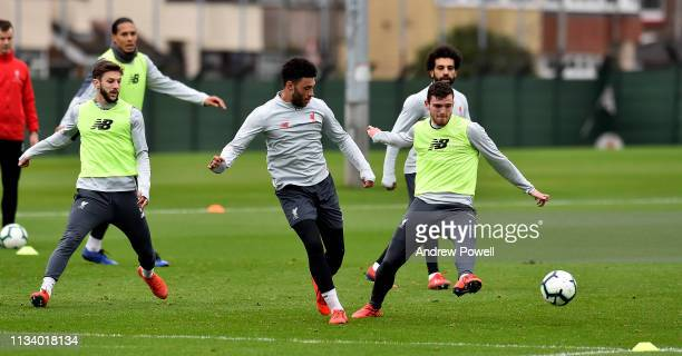 Andy Robertson and Alex OxladeChamberlain of Liverpool during a training session at Melwood Training Ground on March 06 2019 in Liverpool England