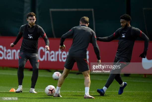 Andy Robertson and Joe Gomez of Liverpool during a training session at Melwood Training Ground on October 29 2020 in Liverpool England