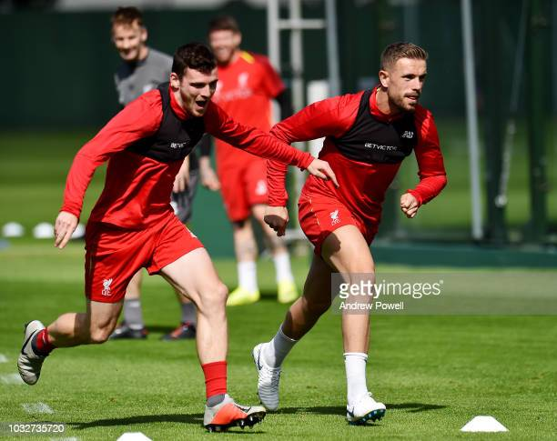 Andy Robertson and Jordan Henderson of Liverpool during a training session at Melwood Training Ground on September 13 2018 in Liverpool England