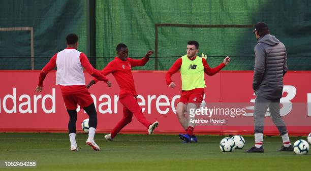 Andy Robertson and Rafael Camacho of Liverpool during a training session at Melwood Training Ground on October 18 2018 in Liverpool England
