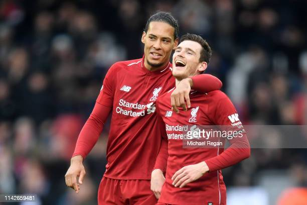 Andy Robertson and Virgil van Dijk of Liverpool celebrate victory after the Premier League match between Liverpool FC and Chelsea FC at Anfield on...