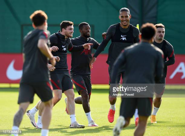 Andy Robertson Georginio Wijnaldum and Virgil van Dijk of Liverpool during a training session at Melwood Training Ground on September 18 2020 in...