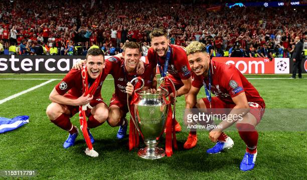 Andy Robertson James Milner Adam Lallana and Alex OxladeChamberlain of Liverpool with the UEFA Champions League trophy the UEFA Champions League...