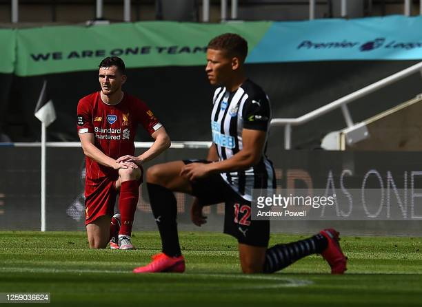 Andy Robertson of Liverpool and Dwight Gayle of Newcastle Take to the knee before the Premier League match between Newcastle United and Liverpool FC...