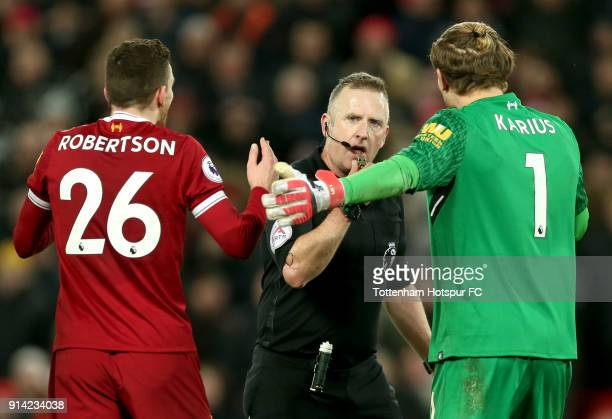 Andy Robertson of Liverpool and Loris Karius of Liverpool appeal to referee Jonathan Moss during the Premier League match between Liverpool and...