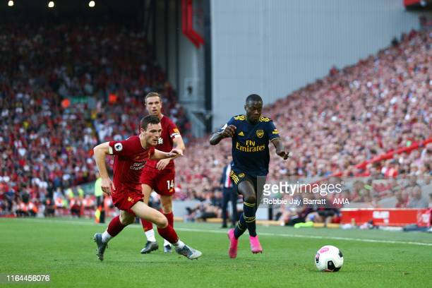 Andy Robertson of Liverpool and Nicolas Pepe of Arsenal during the Premier League match between Liverpool FC and Arsenal FC at Anfield on August 24...