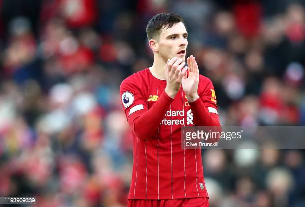Andy Robertson of Liverpool applauds fans following victory in the Premier League match between Liverpool FC and Watford FC at Anfield on December...