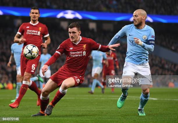 Andy Robertson of Liverpool battles for posession with David Silva of Manchester City during the UEFA Champions League Quarter Final Second Leg match...