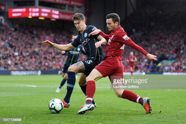 Andy Robertson of Liverpool battles for possession with John Stones of Manchester City during the Premier League match between Liverpool FC and...