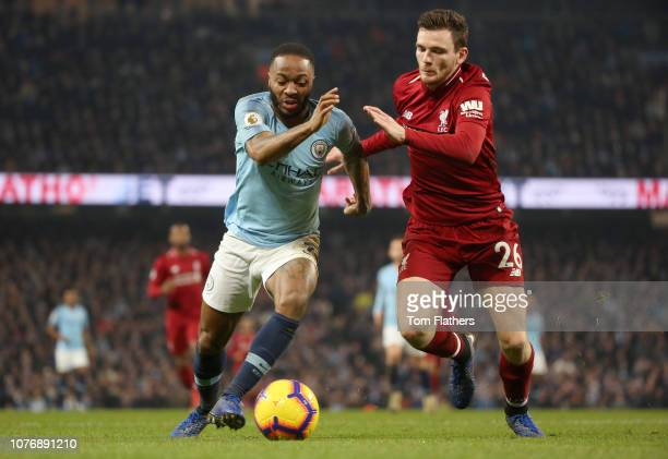 Andy Robertson of Liverpool battles for possession with Raheem Sterling of Manchester City during the Premier League match between Manchester City...