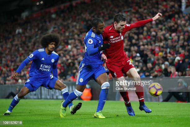 Andy Robertson of Liverpool battles with Ricardo Pereira and Hamza Choudhury of Leicester City during the Premier League match between Liverpool FC...