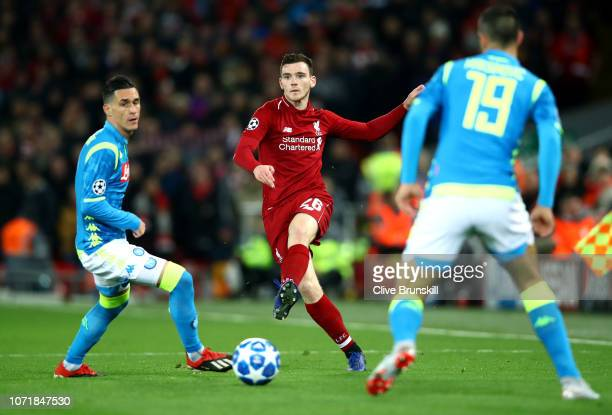 Andy Robertson of Liverpool beats Jose Callejon and Nikola Maksimovic of Napoli during the UEFA Champions League Group C match between Liverpool and...