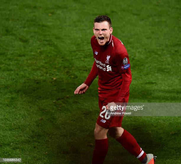 Andy Robertson of Liverpool celebrates after Roberto Firmino scores a goal during the Group C match of the UEFA Champions League between Liverpool...