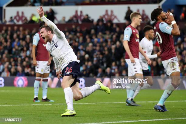 Andy Robertson of Liverpool celebrates after scoring his team's first goal during the Premier League match between Aston Villa and Liverpool FC at...