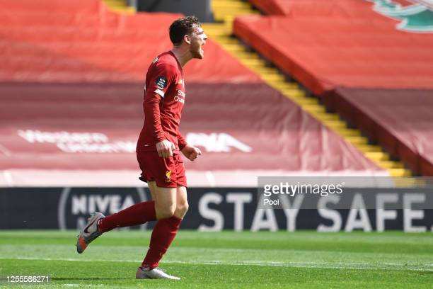 Andy Robertson of Liverpool celebrates after scoring his team's first goal during the Premier League match between Liverpool FC and Burnley FC at...