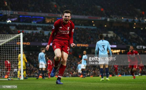 Andy Robertson of Liverpool celebrates his sides first goal during the Premier League match between Manchester City and Liverpool FC at the Etihad...