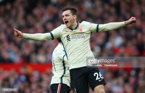 Andy Robertson of Liverpool celebrates the opening goal by Naby Keita during the Premier League match between Manchester United and Liverpool at Old...
