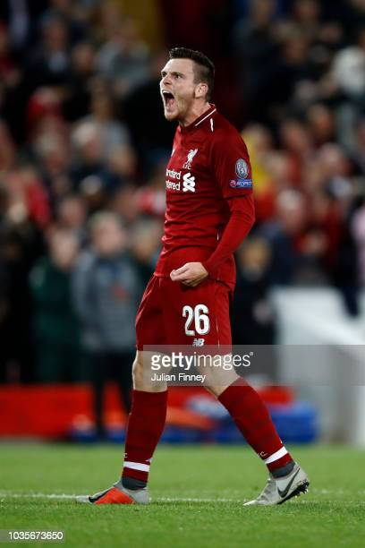 Andy Robertson of Liverpool celebrates victory after the Group C match of the UEFA Champions League between Liverpool and Paris SaintGermain at...