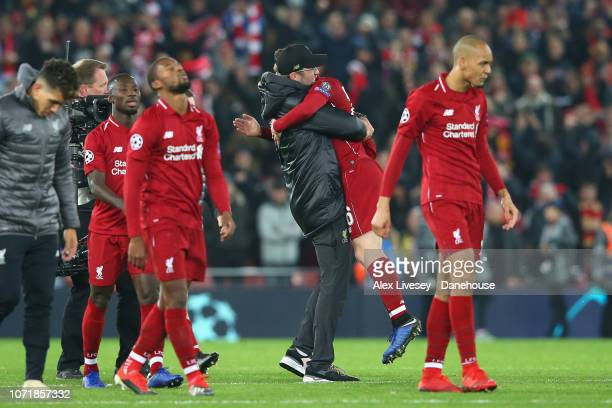 Andy Robertson of Liverpool celebrates with Jurgen Klopp after the UEFA Champions League Group C match between Liverpool and SSC Napoli at Anfield on...