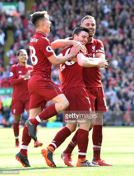 Andy Robertson of Liverpool celebrates with team mates after scoring his sides fourth goal during the Premier League match between Liverpool and...