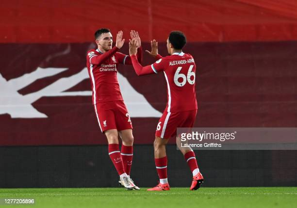 Andy Robertson of Liverpool celebrates with teammate Trent Alexander-Arnold after scoring his sides second goal during the Premier League match...