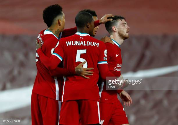 Andy Robertson of Liverpool celebrates with teammates after scoring his sides second goal during the Premier League match between Liverpool and...