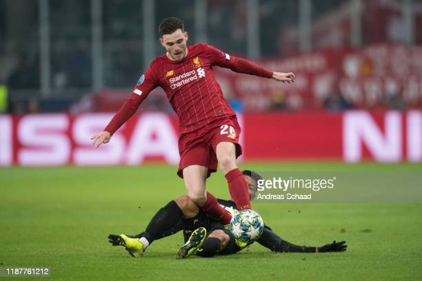 Andy Robertson of Liverpool FC and Heechan Hwang of FC Salzburg the UEFA Champions League group E match between RB Salzburg and Liverpool FC at on...