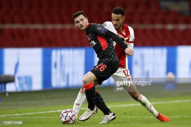 AMSTERDAM Andy Robertson of Liverpool FC Noussair Mazraoui or Ajax during the UEFA Champions League match in group D between Ajax Amsterdam and...