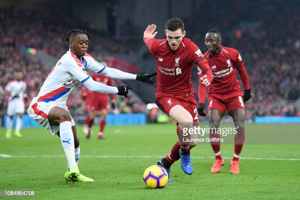 Andy Robertson of Liverpool is challenged by Aaron WanBissaka of Crystal Palace during the Premier League match between Liverpool FC and Crystal...