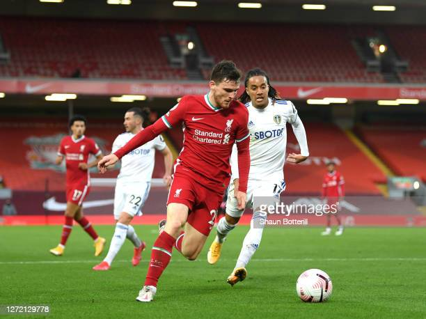 Andy Robertson of Liverpool is challenged by Helder Costa of Leeds United during the Premier League match between Liverpool and Leeds United at...