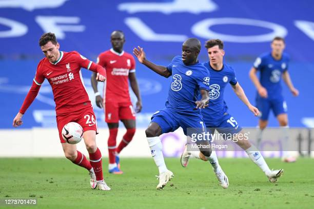 Andy Robertson of Liverpool is challenged by N'Golo Kante of Chelsea during the Premier League match between Chelsea and Liverpool at Stamford Bridge...