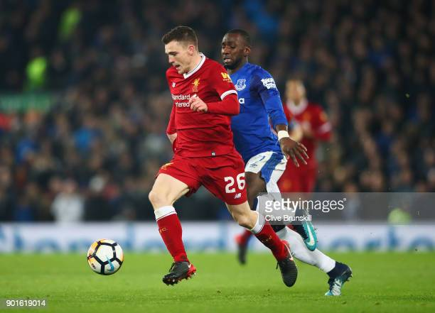 Andy Robertson of Liverpool is chased by Yannick Bolasie during the Emirates FA Cup Third Round match between Liverpool and Everton at Anfield on...