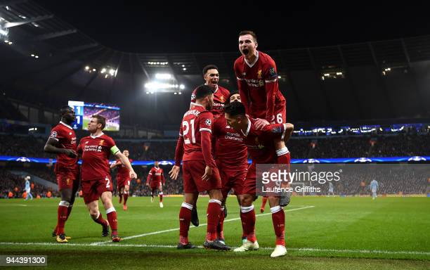 Andy Robertson of Liverpool joins in as Liverpool players celebrate after their sides first goal during the UEFA Champions League Quarter Final...